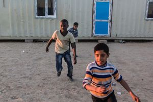 20/01/2015 -- Kirkuk, Iraq -- Omer plays football with his friends in Laylan IDP camp, south of Kirkuk.