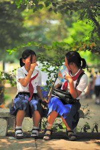 Schoolgirls in Pyongyang Park enjoying some sun.