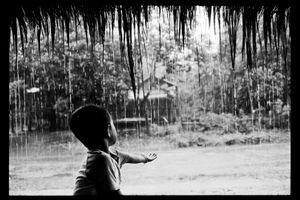 Returning to childhood's shores, Laos. Emotions hurl at me like tropical rain: imperious, salutary, almighty. Through the downpour, I recognize familiar silhouettes: my grandmother Ba, the river's flamboyant bends, the street merchants…Within the confusion of  emotions, the joy of being with my own people is blended with the dim sadness of my exile, like the phantom pain of an amputated limb.