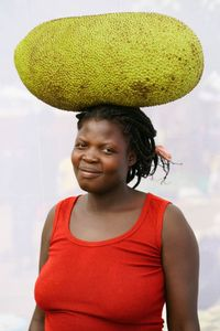 A. Francise: Sells Jackfruit for 500 shillings a slice. Earns 15,000 ($3.20) shillings per day.