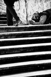 Begging for change at the Spanish Steps in Rome