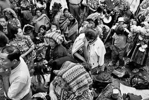 """Family members of """"disappeared"""" people grieve at a vigil on the Day of the Dead at the site of the exhumation in Comalapa. © Victor Blue, 2004"""