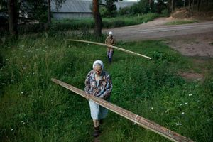 "Planks for a New Fence, Russia, 2009. From the series ""Alekhovshchina: Two Sisters"" © Nadia Sablin"