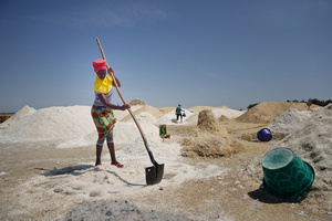 Even very young women work very hard under the hot sun at the salty shore of the lake.