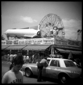 Girl and Cop Car at Coney Island, NY