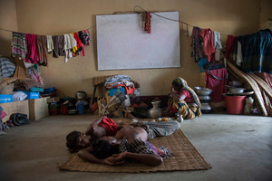 A flood affected family takes shelter at a school in Tala, Satkhira, Bangladesh