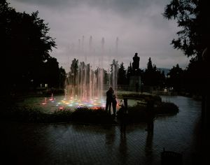 UNRECOGNIZED REPUBLIC OF NAGORNO-KARABAKH / Stepanakert / 28.08.2011. Couples photograph themselves in front of the illuminated water gardens near Independence Square.