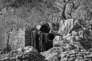 A far from the main festival, woman are pilgrimage the Pir-e Shliyar tomb. Beside the tomb, there is holy stone that people believed that has power and every year for blessing they cut small part of the main stone and again believed that next year main stone will grow and be the same as last year.