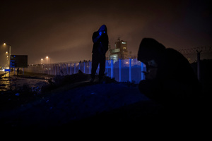 """Night life of refugees at the so-called """"Jungle"""" migrant camp in the northern French city of Calais on November 4, 2015."""