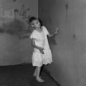 Girl in white dress, 2002, from the series Boarding House © Roger Ballen