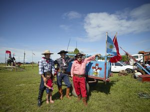 Gauchito Gil devotees next to their carriage, at the national gathering in Mercedes town for  the celebrations of January 8, date of the murder of the popular saint