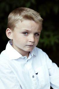Young jockey with a black eye