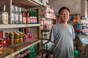 Li lost both of his arms in an industrial accident. Support from the Disabled Persons' Federation allowed him to open a shop, not only providing practical support but also helping him to integrate into the local community.