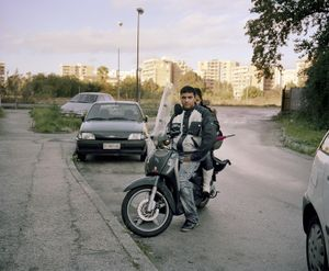 "Scampia, Naples. ""The killer of Scampia,"" 31 years old, with his girlfriend at the Vela Rossa, the most notorious of three buildings in the Scampia neighborhood of Naples. He served 12 years in prison for a murder he committed when he was 19. He has two trials going at the moment for robbery and some misdemeanor crimes for which he might serve another 20 months. He and his girlfriend were arguing when I met them. He agreed to me taking the portrait, she didn't. © Valerio Spada."