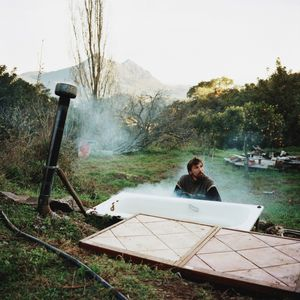 Julian working on a bathtub, Sierra del Hacho, Spain, 2013 © Antoine Bruy