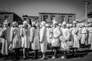"Nurses line up to march for independence celebrations. Tskhinvali, 2005. From the book ""Woman With a Monkey—Caucasus in Short Notes and Photographs."""