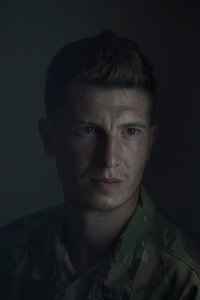 Elf, 29, worker, paratrooper, picture was taken after he spent 12 months in the war zone, July 2015, Ukraine.