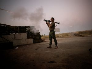 A volunteer shooting the Ukrainian lines with a rocket-propelled grenade. The two forces attack nightly ignoring the current ceasefire.
