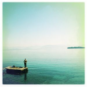 (Phaeacians Island) - Corfu Greece, May 2012 - The photograph depicts a man during vacation in Corfu. According to hellenist Victor Berard, this is where the episode of Odysseus and the Phaeacians took place.