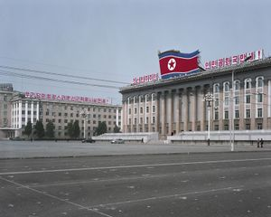 Kim Il Sung Square. This is Pyongyang's most important square and a common gathering place for rallies, dances and military parades. The white dots on the ground are positioning marks. © Maxime Delvaux