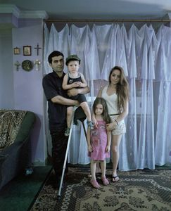 "Veterans, Georgia. Raphael Dolinian with family. From the series ""Mother"""