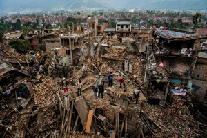 Residents forage through their destroyed homes, gathering salvageable belongings. Bhaktapur, Nepal, 29 April 2015.