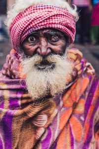 Indian beggar in colorful rags