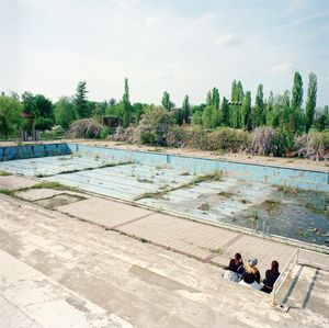 Girls sitting at the Borovo Naselje Olympic-sized swimming pool. © Colin Dutton