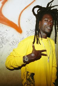 Mame Ngor M'Boup of Baye Fall Sisteme music management poses for a snapshot, while he explains that Senegalese hip hop is number three in the world after the U.S. and France. He projects that Senegal could soon move up the ranks. © Sharon Stark