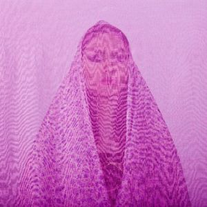 Yalda, an Iranian woman is photographed through the fabric of her hijab (the Islamic headscarf worn by women in the presence adult men who are not members of her immediate family). Since the Islamic revolution in 1979, Iranian women are not allowed to be seen in public without proper Islamic head dress in Iran. Not wearing a proper hijab is illegal and can result in arrest by a special police unit