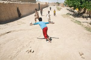 © Iva Zimova. Boys play a soccer game on the street of Mazar – e Sharif.