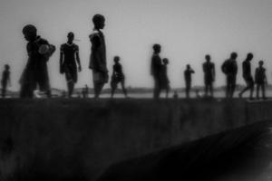 Runaway talibes stand on the bank of Senegal river, Saint Louis, Senegal, 20May 2015.