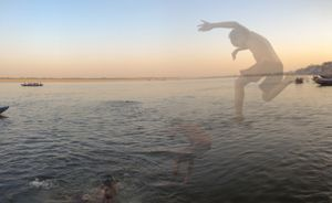 Boys dive into the Ganges river at Varanasi.