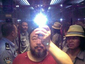 Ai Weiwei with rockstar Zuoxiao Zuzhou in the elevator when taken in custody by the police. Sichuan, China, August 2009. © Ai Weiwei.