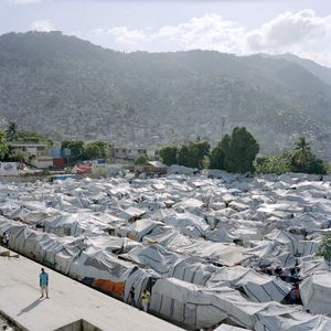 Tent city on a soccer field that belongs to a church. After the earthquake, inhabitants of makeshift districts sometimes pitched tents in the camps to benefit from NGO help. The most visible camps in public squares were dismantled. Pétion-Ville. © Paolo Woods/INSTITUTE