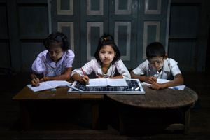 10 year old students do their homework in a solar-powered after-school community center near in Taman Chan Village, in Dala Township.