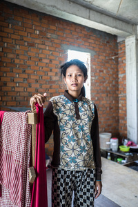 Khang Chet 25, moved to Phnom Penh a year ago with her husband and daughter. The family stay on the construction site. Chet is concerned for her family's welfare and despite the construction company offering health care she is unaware what would happen if she was seriously injured.