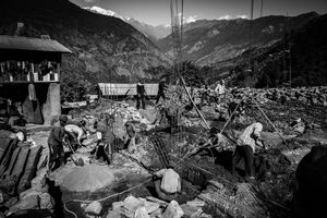 Men rebuilding houses destroyed by the earthquake of April 2015. Mandre, Gorkha District, near the epicenter.