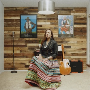 Musician Kelli Brooke, 33, is the daughter of the internationally recognized Native American artist and former Chief of the Seminole Nation, Enoch Kelly Haney. Pictured, she wears a hand-stitched Seminole skirt and is draped in Native American turquoise jewelry and accessories. Kelli Brooke is photographed in her home where she spends her time writing and recording her music.
