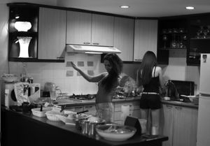 © Nafise Motlaq - She dances in the kitchen while preparing an Iranian dish with her friend.