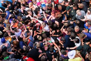 3rd prize singles © Uwe Weber, Germany, for Bild. Crowd throngs at entrance to Love Parade, Duisburg, Germany, 24 July