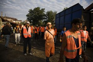 The first city workers, many of them Roma themselves, arrive at the Nova Gazela settlement at 7am on August 31, 2009 to help with the relocation and destruction of the camps. © Matt Lutton