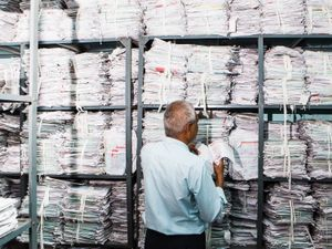 A worker organises medical records of the biggest government hospital in asia. [Civil Hospital, Ahmedabad]