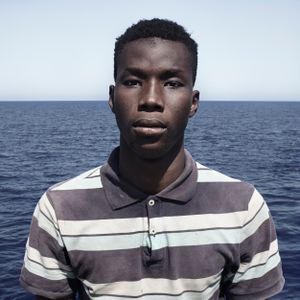 Mediterranean Sea, 1 August 2016. Mulie (17), from Mauritania, poses for a portrait minutes after being rescued on the Mediterranean Sea, 20 nautical miles off the Libyan coast by a rescue vessel provided by the NGO Jugend Rettet. The rubber boat in which he travelled carried 118 people on board, who were transferred by the Italian Coast Guard to Lampedusa (Italy).