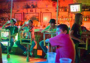 Group of teenagers at Barracuda Bar. Zihuatanejo.