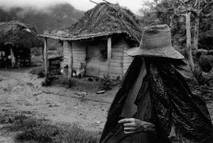 Guillermo in rain cape © Susan S. Bank