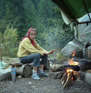 Young girl in mushroom pickers' camp