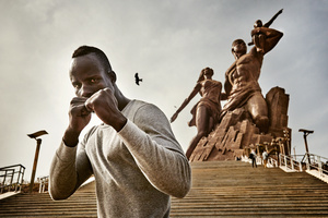 "March 3, 2015. Kherou Ngor, a young, successful light weight-Wrestler from the Ngor district in Dakar, trains three times a week on the long stair of the ""monument of the African Renaissance"". It is one of the biggest bronze statues of the world whose disputed, North Korean aesthetics and insane building cost prevented the former Senegalese president Abdoulaye Wade's re-election."