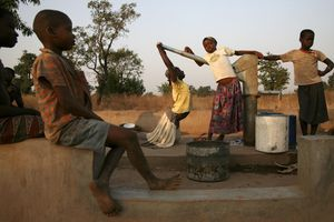 © Peter DiCampo (United States) Children wait to fetch water at a drilled borehole well in Wantugu, Ghana, December 21, 2006. Honorable Mention, LensCulture Exposure Awards 2009