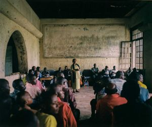 "Henriette Useni Kabake, Lulingu's government administrator, hosts a town meeting alongside traditional and RM leaders inside a decayed building from the Belgian colonial era. The RM insist they should not be labeled ""rebels"" like other armed groups operating in Congo, citing that they have not interfered with the work of government officials in their territory. © Diana Zeyneb Alhindawi"